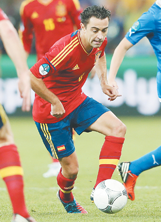 One of world's best: Xavi in action for Spain