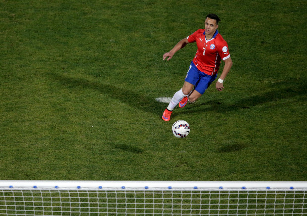 History: Sanchez clips home the clinching penalty (Photo by Ricardo Moraes / Action Images)