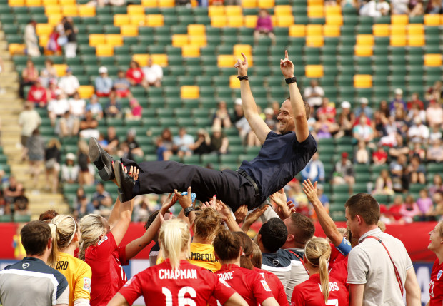 On a high: England hoist boss Mark Sampson as they celebrate victory over the Germans (Photo by Erich Schlegel / Action Images)