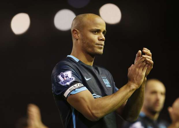 "Football Soccer - Liverpool v Manchester City - Barclays Premier League - Anfield - 2/3/16 Manchester City's Vincent Kompany applauds the fans at the end of the game Action Images via Reuters / Lee Smith Livepic EDITORIAL USE ONLY. No use with unauthorized audio, video, data, fixture lists, club/league logos or ""live"" services. Online in-match use limited to 45 images, no video emulation. No use in betting, games or single club/league/player publications. Please contact your account representative for further details."